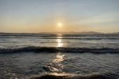 Gyonyoru a naplemente a parton